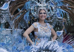 The carnival queens' costumes are full of sparkle and color