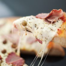 Porción de pizza en Picsa