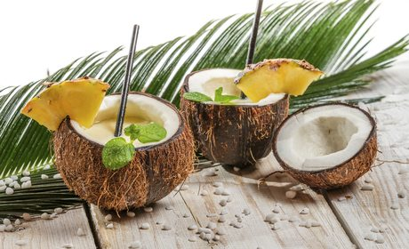 Surprise your guests by serving piña colada in a coconut